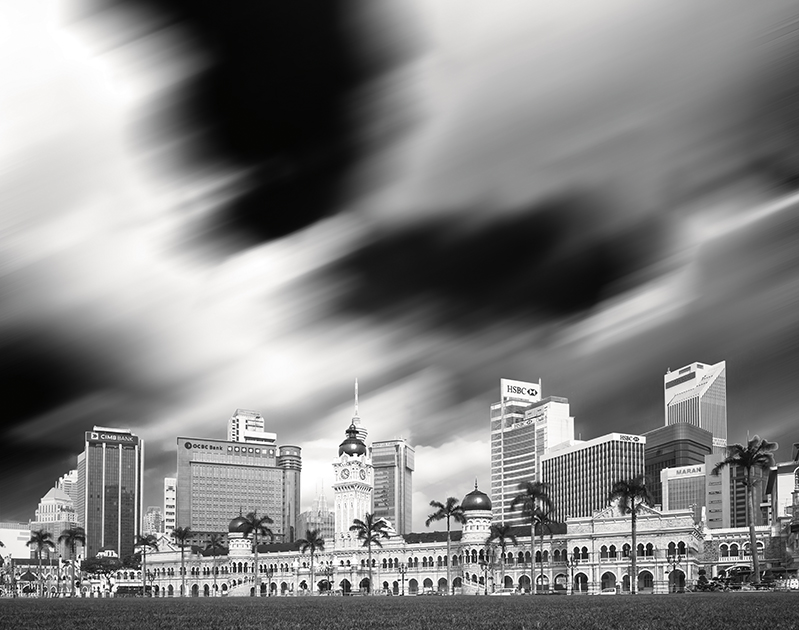 View towards The Sultan Abdul Samad Building (Malay: Bangunan Sultan Abdul Samad) from the Dataran Merdeka (Independence Square). Day light long exposure using filter. Strong contrast black and white conversion.